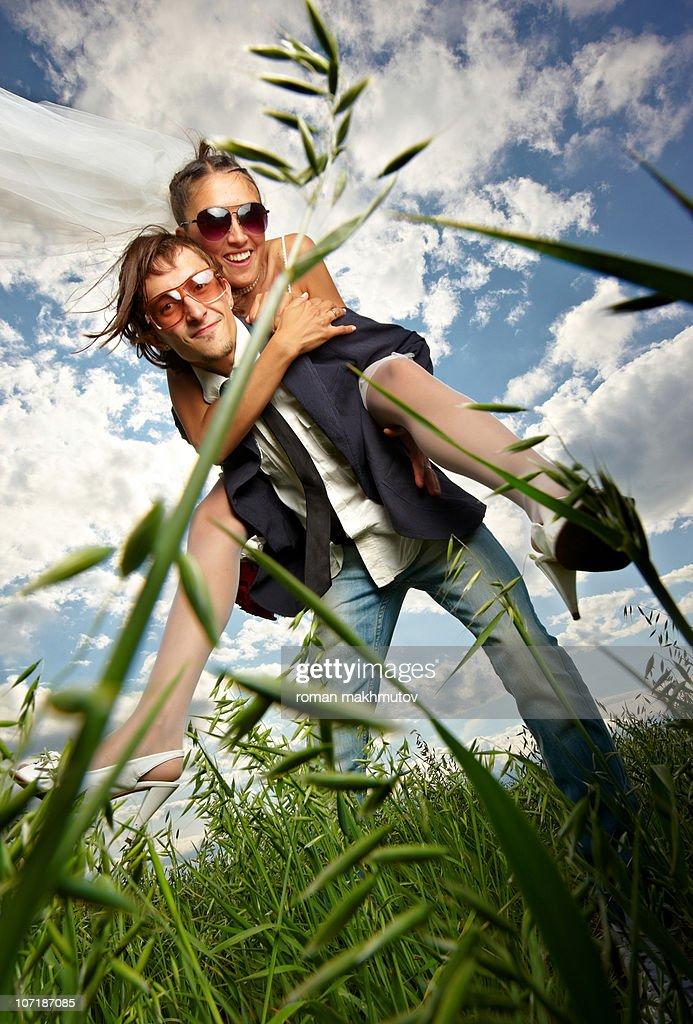 Energetic Creative Bride and Groom : Stock Photo