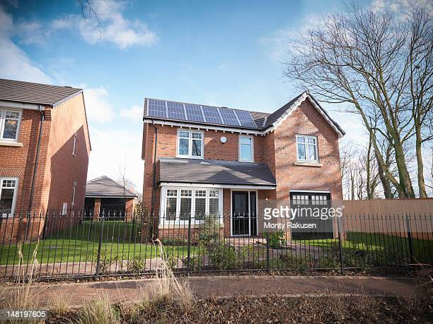 Energy efficient house with solar panels on roof