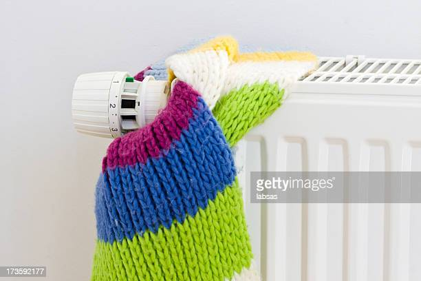 Energy saving concept with a knit scarf tied to a radiator