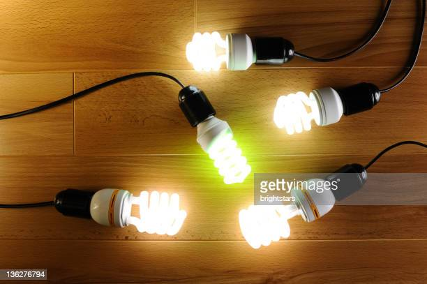Energy saving light bulbs on hardwood