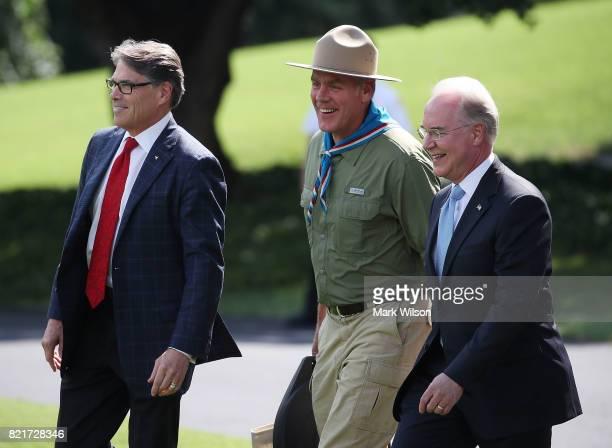 Energy Secretary Rick Perry Interior Secretary Ryan Zinke and HHS Secretary Tom Price walk to Marine One to depart with US President Donald Trump...