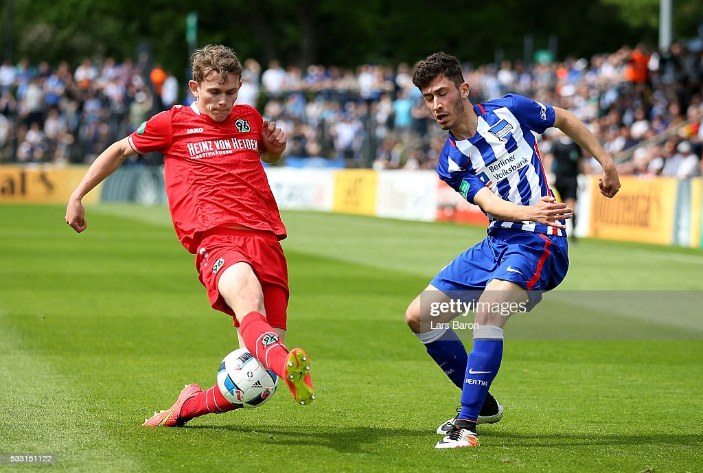 Enes Akyol of Berlin is challenged by Jonas Morison of Hanover during the DFB Juniors Cup Final 2016 between Hertha BSC U19 and Hannover 96 U19 at...