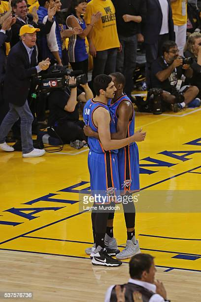 Enes Kanter and Kevin Durant of the Oklahoma City Thunder hug in Game Five of the Western Conference Finals against the Golden State Warriors during...