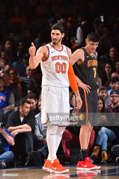 Enes Kanter of the New York Knicks gives the thumbs up after scoring against the Atlanta Hawks at Madison Square Garden on December 10 2017 in New...
