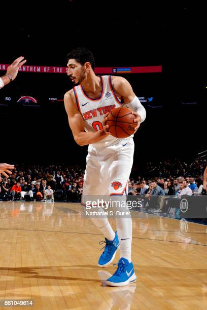 Enes Kanter of the New York Knicks handles the ball against the Washington Wizards on October 13 2017 at Madison Square Garden in New York City New...