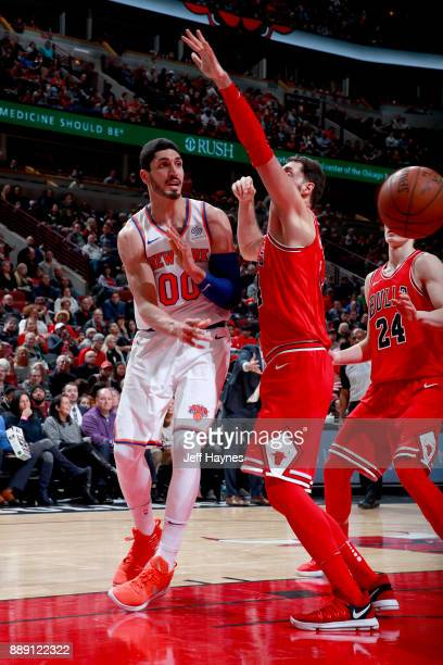 Enes Kanter of the New York Knicks passes the ball against the Chicago Bulls on December 9 2017 at the United Center in Chicago Illinois NOTE TO USER...
