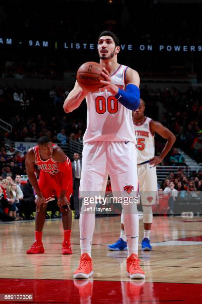 Enes Kanter of the New York Knicks shoots a free throw against the Chicago Bulls on December 9 2017 at the United Center in Chicago Illinois NOTE TO...