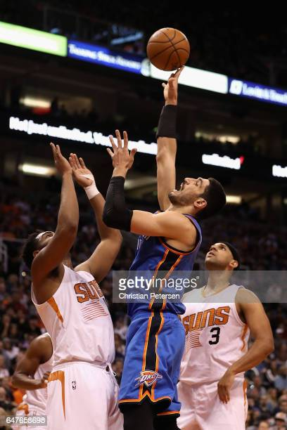 Enes Kanter of the Oklahoma City Thunder attempts a shot over Alan Williams of the Phoenix Suns during the first half of the NBA game at Talking...
