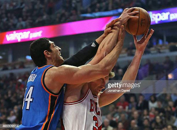 Enes Kanter of the Oklahoma City Thunder battles for a rebound with Mike Dunleavy of the Chicago Bulls at the United Center on March 5 2015 in...