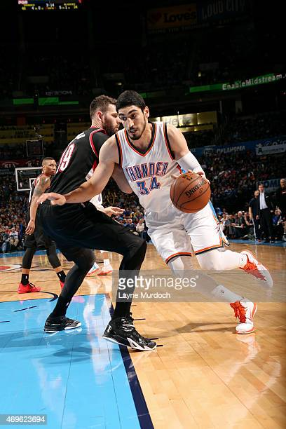 Enes Kanter of the Oklahoma City Thunder drives against the Portland Trail Blazers on April 13 2015 at Chesapeake Energy Arena in Oklahoma City...
