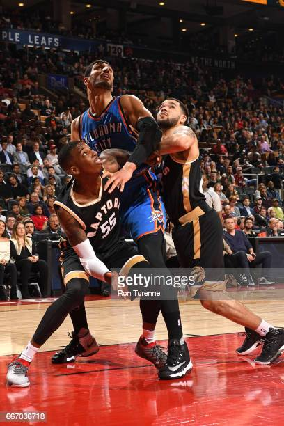 Enes Kanter of the Oklahoma City Thunder fights for the position against Delon Wright and Fred VanVleet of the Toronto Raptors on March 16 2017 at...