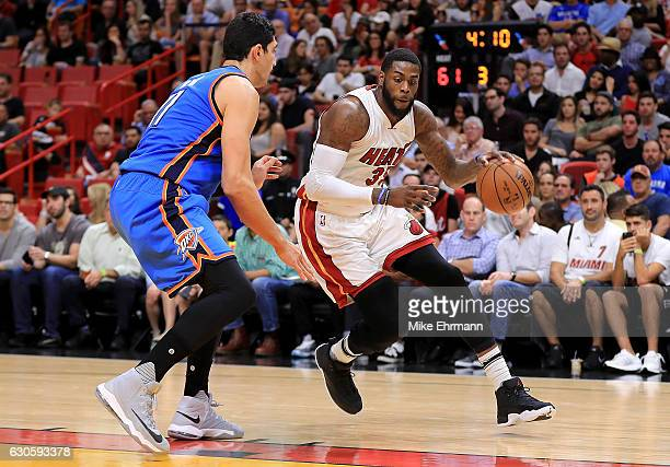 Enes Kanter of the Oklahoma City Thunder guards Willie Reed of the Miami Heat during a game at American Airlines Arena on December 27 2016 in Miami...