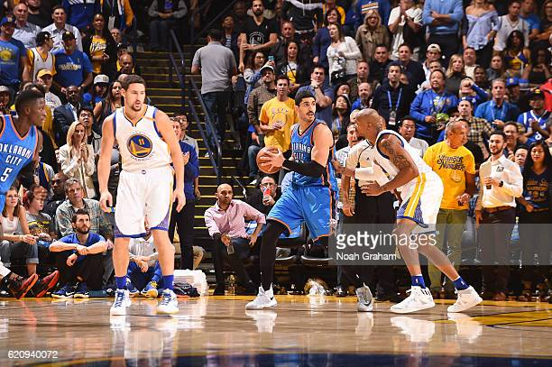 Enes Kanter of the Oklahoma City Thunder handles the ball against David West of the Golden State Warriors during a game on November 3 2016 at ORACLE...