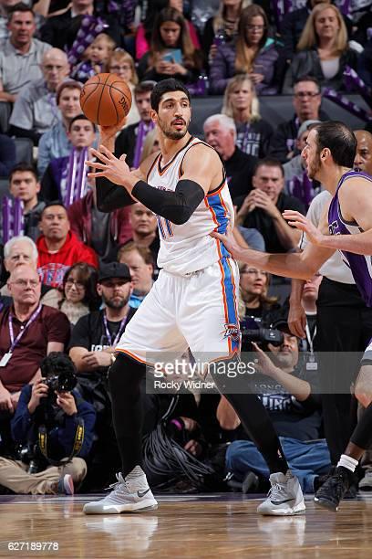 Enes Kanter of the Oklahoma City Thunder handles the ball against Kosta Koufos of the Sacramento Kings on November 23 2016 at Golden 1 Center in...