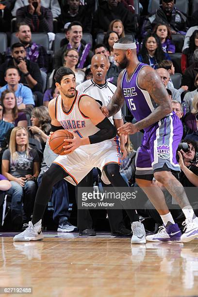 Enes Kanter of the Oklahoma City Thunder handles the ball against DeMarcus Cousins of the Sacramento Kings on November 23 2016 at Golden 1 Center in...
