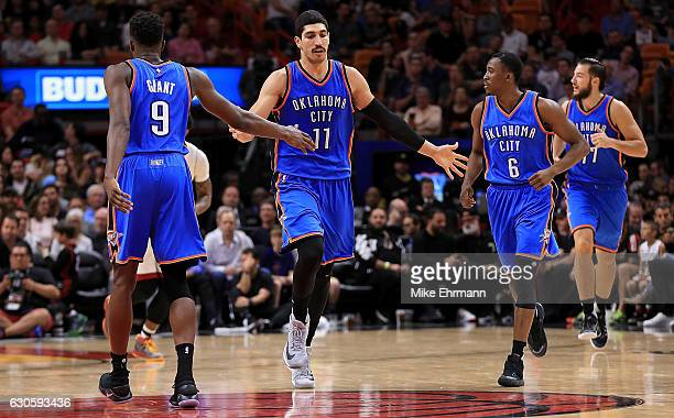 Enes Kanter of the Oklahoma City Thunder is congratulated during a game against the Miami Heat at American Airlines Arena on December 27 2016 in...