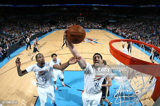 Enes Kanter of the Oklahoma City Thunder jumps for the rebound against the Utah Jazz during the game on March 24 2016 at Chesapeake Energy Arena in...