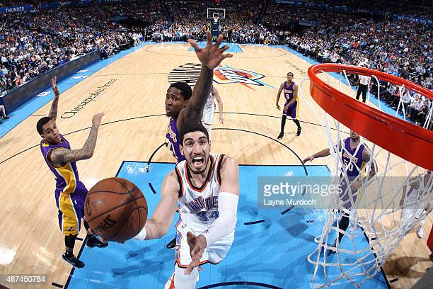 Enes Kanter of the Oklahoma City Thunder shoots against the Los Angeles Lakers on March 24 2014 at Chesapeake Energy Arena in Oklahoma City OK NOTE...