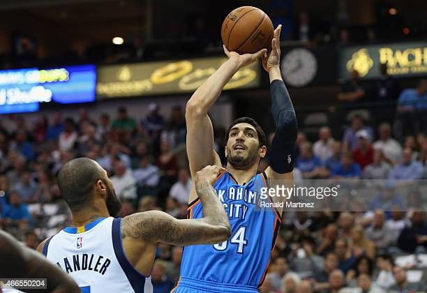 Enes Kanter of the Oklahoma City Thunder takes a shot against Tyson Chandler of the Dallas Mavericks at American Airlines Center on March 16 2015 in...