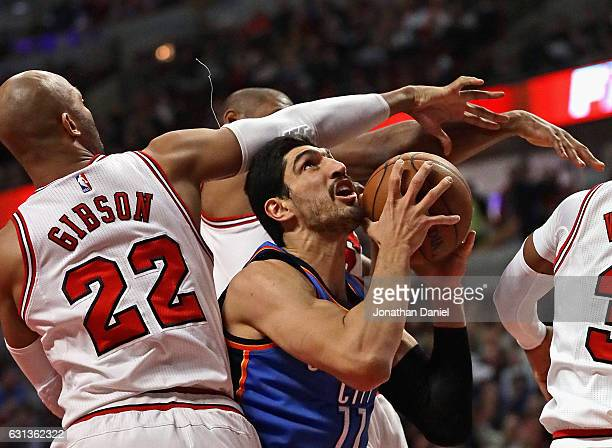 Enes Kanter of the Oklahoma City Thunder tries to get off a shot against Taj Gibson and Cristiano Felicio of the Chicago Bulls at the United Center...