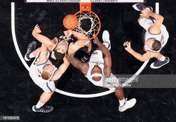 Enes Kanter of the Utah Jazz and Reggie Evans of the Brooklyn Nets go up for a rebound during a game at Barclays Center on November 5 2013 in the...