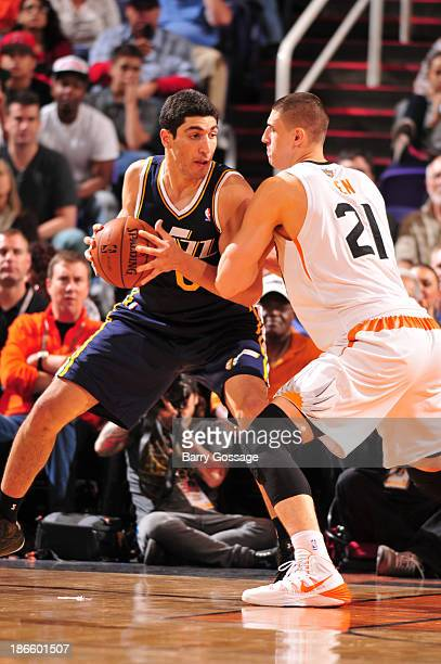 Enes Kanter of the Utah Jazz controls the ball against Alex Len of the Phoenix Suns on November 1 2013 at US Airways Center in Phoenix Arizona NOTE...