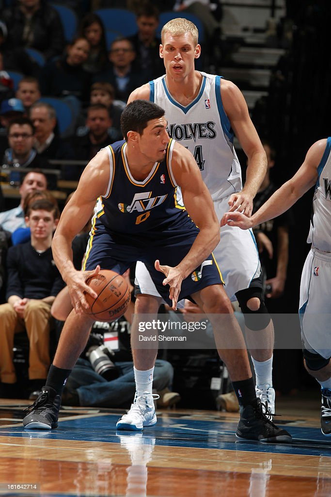 Enes Kanter #0 of the Utah Jazz controls the ball against Greg Stiemsma #34 of the Minnesota Timberwolves on February 13, 2013 at Target Center in Minneapolis, Minnesota.