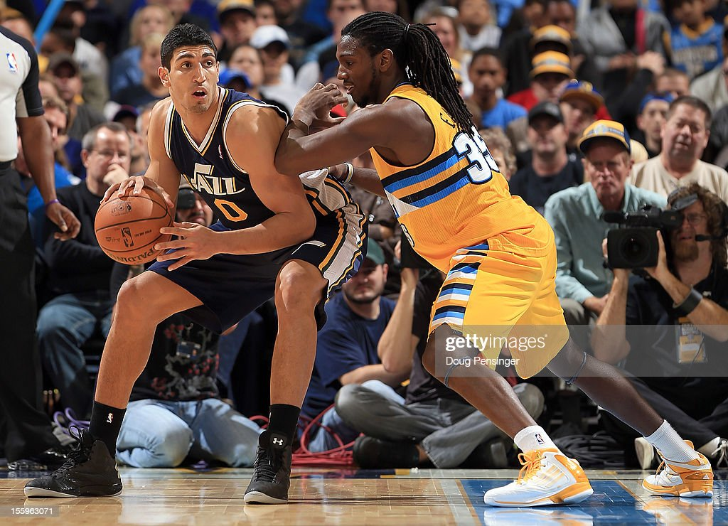 <a gi-track='captionPersonalityLinkClicked' href=/galleries/search?phrase=Enes+Kanter&family=editorial&specificpeople=5621416 ng-click='$event.stopPropagation()'>Enes Kanter</a> #0 of the Utah Jazz controls the ball against the defense of <a gi-track='captionPersonalityLinkClicked' href=/galleries/search?phrase=Kenneth+Faried&family=editorial&specificpeople=5765135 ng-click='$event.stopPropagation()'>Kenneth Faried</a> #35 of the Denver Nuggets at the Pepsi Center on November 9, 2012 in Denver, Colorado. The Nuggets defeated the Jazz 104-84.
