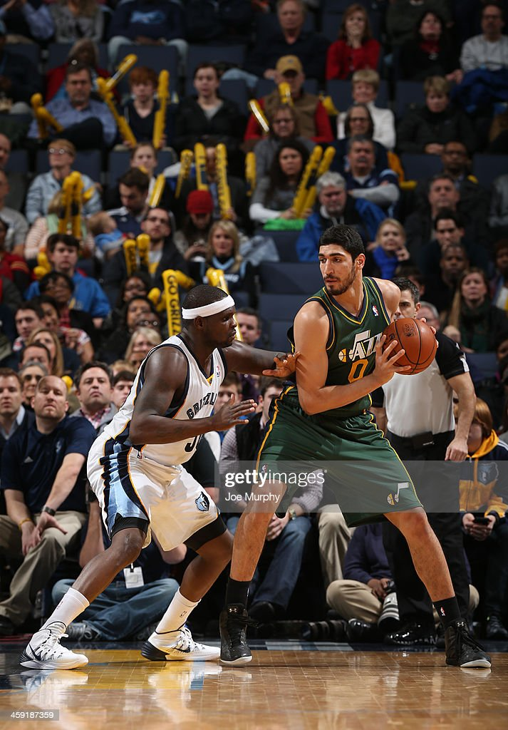 Enes Kanter #0 of the Utah Jazz controls the ball against Zach Randolph #50 of the Memphis Grizzlies on December 23, 2013 at FedExForum in Memphis, Tennessee.