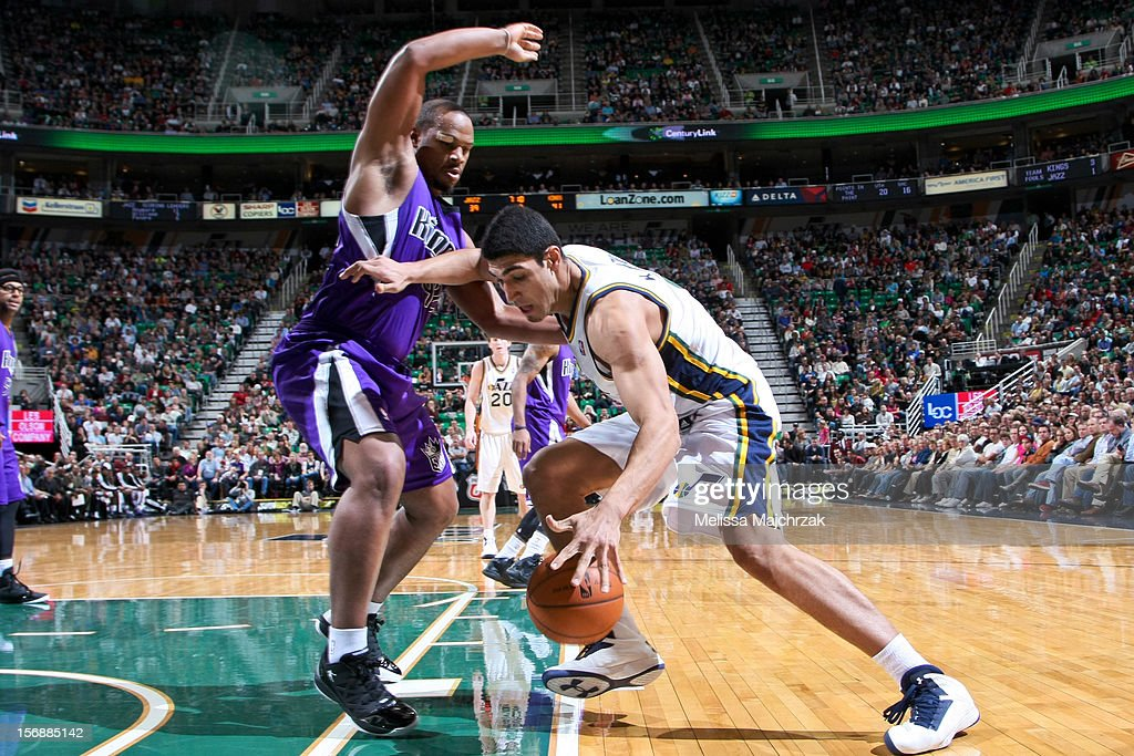 Enes Kanter #0 of the Utah Jazz drives against Chuck Hayes #42 of the Sacramento Kings at Energy Solutions Arena on November 23, 2012 in Salt Lake City, Utah.