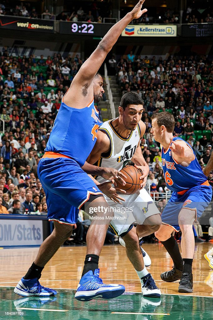 <a gi-track='captionPersonalityLinkClicked' href=/galleries/search?phrase=Enes+Kanter&family=editorial&specificpeople=5621416 ng-click='$event.stopPropagation()'>Enes Kanter</a> #0 of the Utah Jazz drives against <a gi-track='captionPersonalityLinkClicked' href=/galleries/search?phrase=Kurt+Thomas&family=editorial&specificpeople=201800 ng-click='$event.stopPropagation()'>Kurt Thomas</a> #40 of the New York Knicks at Energy Solutions Arena on March 18, 2013 in Salt Lake City, Utah.