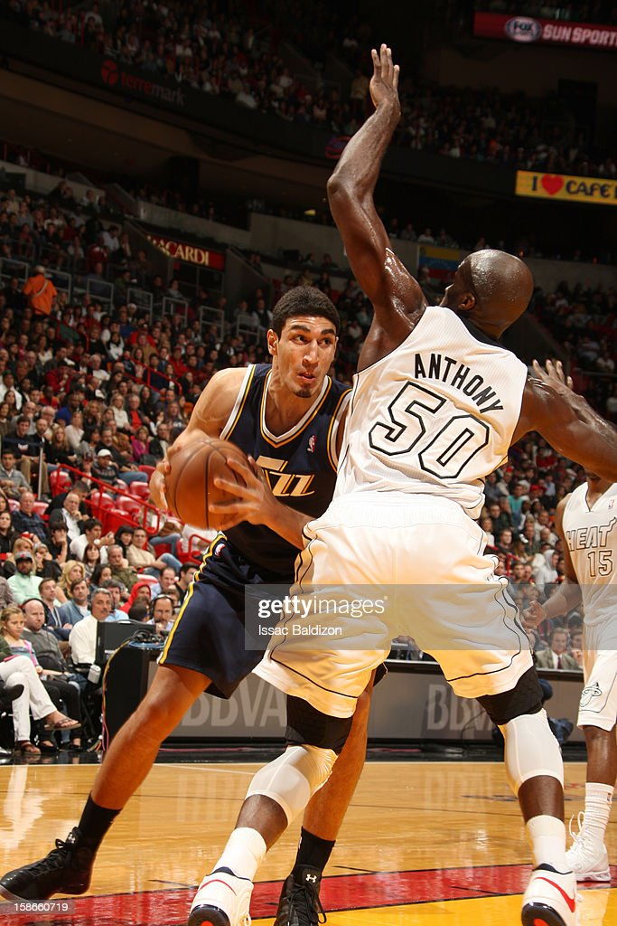 <a gi-track='captionPersonalityLinkClicked' href=/galleries/search?phrase=Enes+Kanter&family=editorial&specificpeople=5621416 ng-click='$event.stopPropagation()'>Enes Kanter</a> #0 of the Utah Jazz drives around defense of <a gi-track='captionPersonalityLinkClicked' href=/galleries/search?phrase=Joel+Anthony&family=editorial&specificpeople=4092295 ng-click='$event.stopPropagation()'>Joel Anthony</a> #50 of the Miami Heat during the game between the Utah Jazz and the Miami Heat on December 22, 2012 at American Airlines Arena in Miami, Florida.