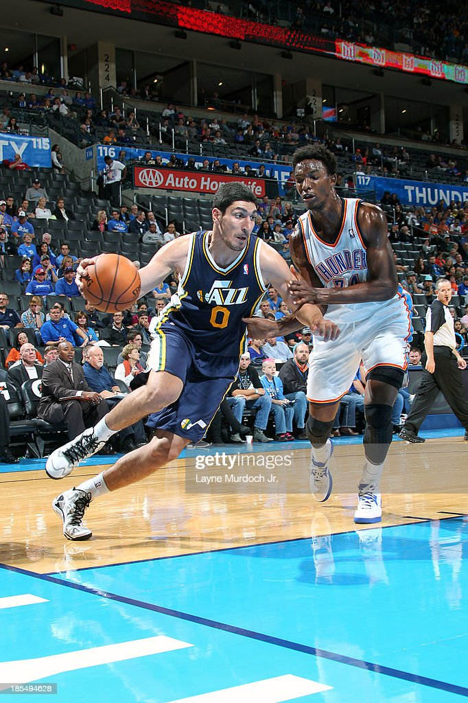 <a gi-track='captionPersonalityLinkClicked' href=/galleries/search?phrase=Enes+Kanter&family=editorial&specificpeople=5621416 ng-click='$event.stopPropagation()'>Enes Kanter</a> #0 of the Utah Jazz drives baseline against the Oklahoma City Thunder during an NBA preseason game on October 20, 2013 at the Chesapeake Energy Arena in Oklahoma City, Oklahoma.