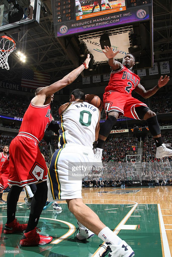 Enes Kanter #0 of the Utah Jazz drives to the basket against Nate Robinson #2 and Carlos Boozer #5 of the Chicago Bulls at Energy Solutions Arena on February 08, 2013 in Salt Lake City, Utah.