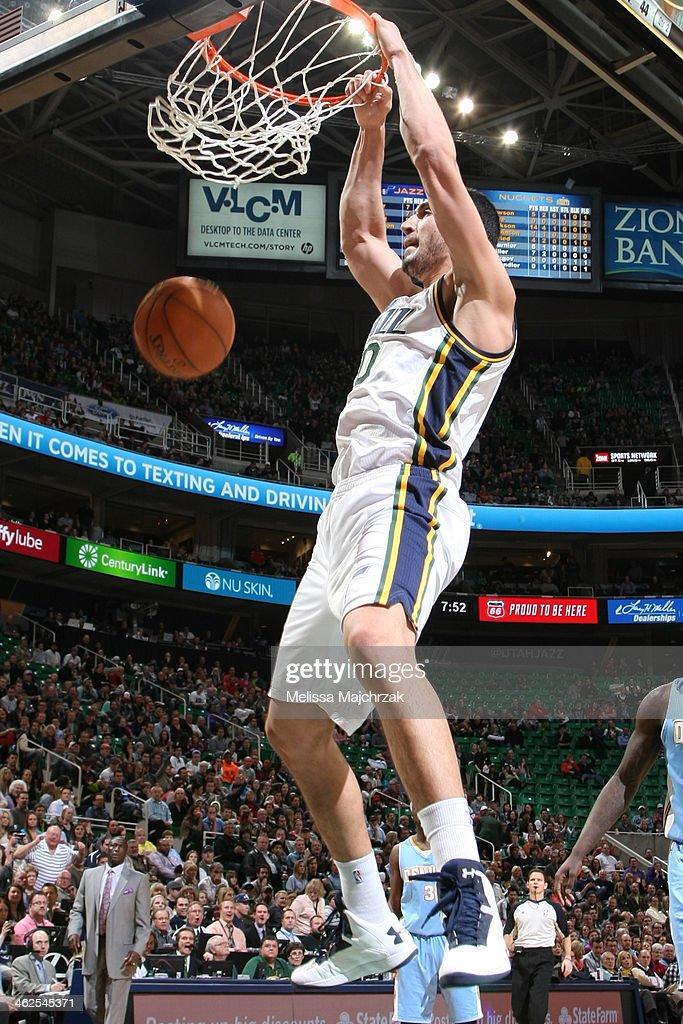 Enes Kanter #0 of the Utah Jazz dunks against the Denver Nuggets at EnergySolutions Arena on January 13, 2014 in Salt Lake City, Utah.