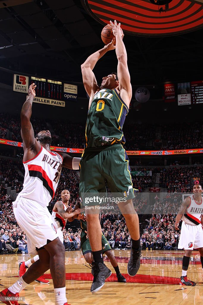 Enes Kanter #0 of the Utah Jazz goes for a jump shot during the game between the Utah Jazz and the Portland Trail Blazers on February 2, 2013 at the Rose Garden Arena in Portland, Oregon.