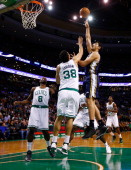 Enes Kanter of the Utah Jazz goes up for a layup in front of Vitor Faverani of the Boston Celtics in the first quarter at TD Garden on November 6...