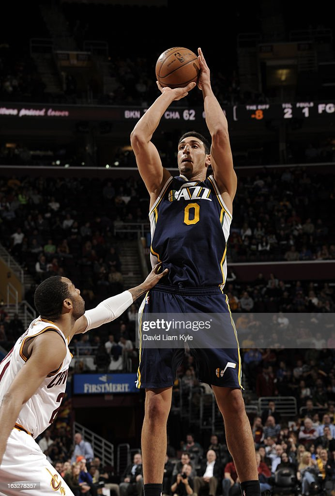 Enes Kanter #0 of the Utah Jazz goes up for the shot against Wayne Ellington #21 of the Cleveland Cavaliers at The Quicken Loans Arena on March 6, 2013 in Cleveland, Ohio.