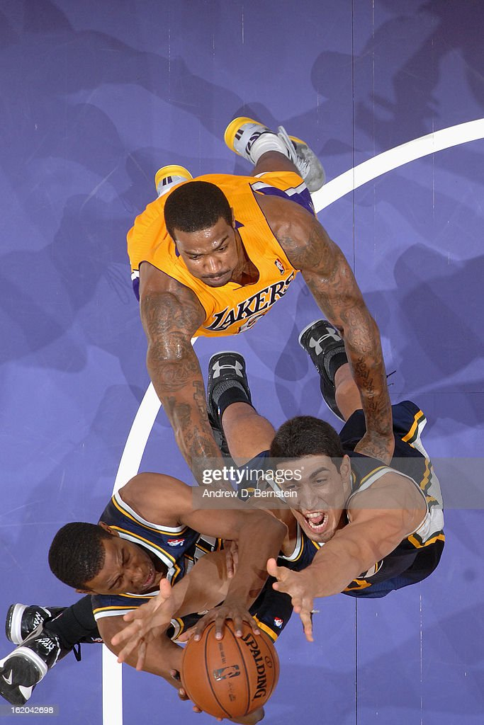 <a gi-track='captionPersonalityLinkClicked' href=/galleries/search?phrase=Enes+Kanter&family=editorial&specificpeople=5621416 ng-click='$event.stopPropagation()'>Enes Kanter</a> #0 of the Utah Jazz grabs a rebound against the Los Angeles Lakers at Staples Center on January 25, 2013 in Los Angeles, California.