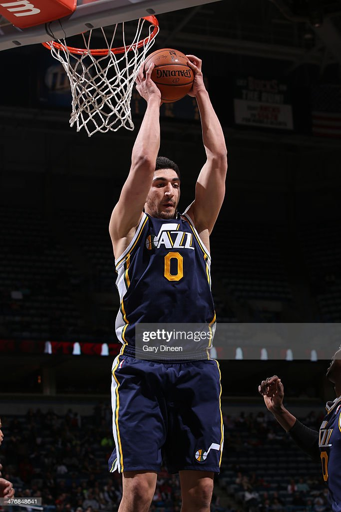 Enes Kanter #0 of the Utah Jazz grabs a rebound against the Milwaukee Bucks on March 3, 2014 at the BMO Harris Bradley Center in Milwaukee, Wisconsin.