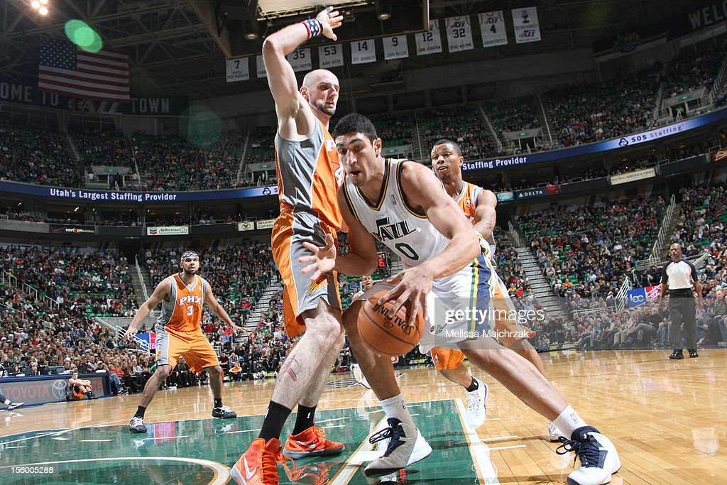 Enes Kanter #0 of the Utah Jazz looks to make his move on Marcin Gortat #4 of the Phoenix Suns at Energy Solutions Arena on November 10, 2012 in Salt Lake City, Utah.
