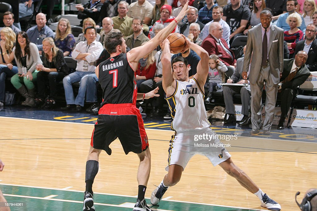 <a gi-track='captionPersonalityLinkClicked' href=/galleries/search?phrase=Enes+Kanter&family=editorial&specificpeople=5621416 ng-click='$event.stopPropagation()'>Enes Kanter</a> #0 of the Utah Jazz looks to pass around <a gi-track='captionPersonalityLinkClicked' href=/galleries/search?phrase=Andrea+Bargnani&family=editorial&specificpeople=533014 ng-click='$event.stopPropagation()'>Andrea Bargnani</a> #7 of the Toronto Raptors at Energy Solutions Arena on December 07, 2012 in Salt Lake City, Utah.