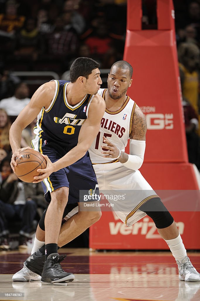 <a gi-track='captionPersonalityLinkClicked' href=/galleries/search?phrase=Enes+Kanter&family=editorial&specificpeople=5621416 ng-click='$event.stopPropagation()'>Enes Kanter</a> #0 of the Utah Jazz looks to pass the ball against the Cleveland Cavaliers at The Quicken Loans Arena on March 6, 2013 in Cleveland, Ohio.