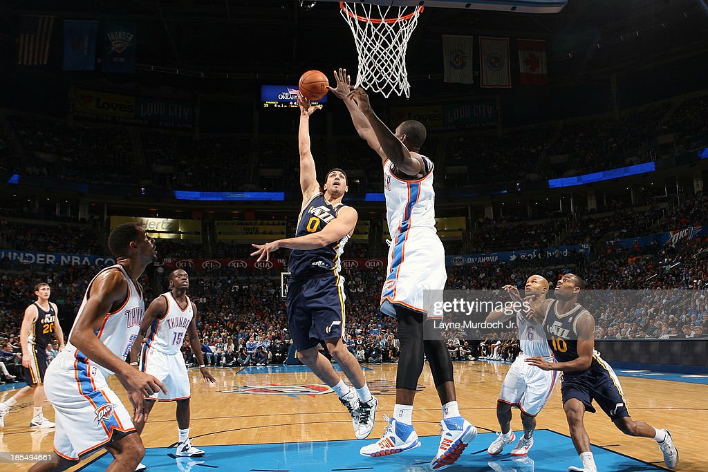 <a gi-track='captionPersonalityLinkClicked' href=/galleries/search?phrase=Enes+Kanter&family=editorial&specificpeople=5621416 ng-click='$event.stopPropagation()'>Enes Kanter</a> #0 of the Utah Jazz puts up the shot against the Oklahoma City Thunder during an NBA preseason game on October 20, 2013 at the Chesapeake Energy Arena in Oklahoma City, Oklahoma.