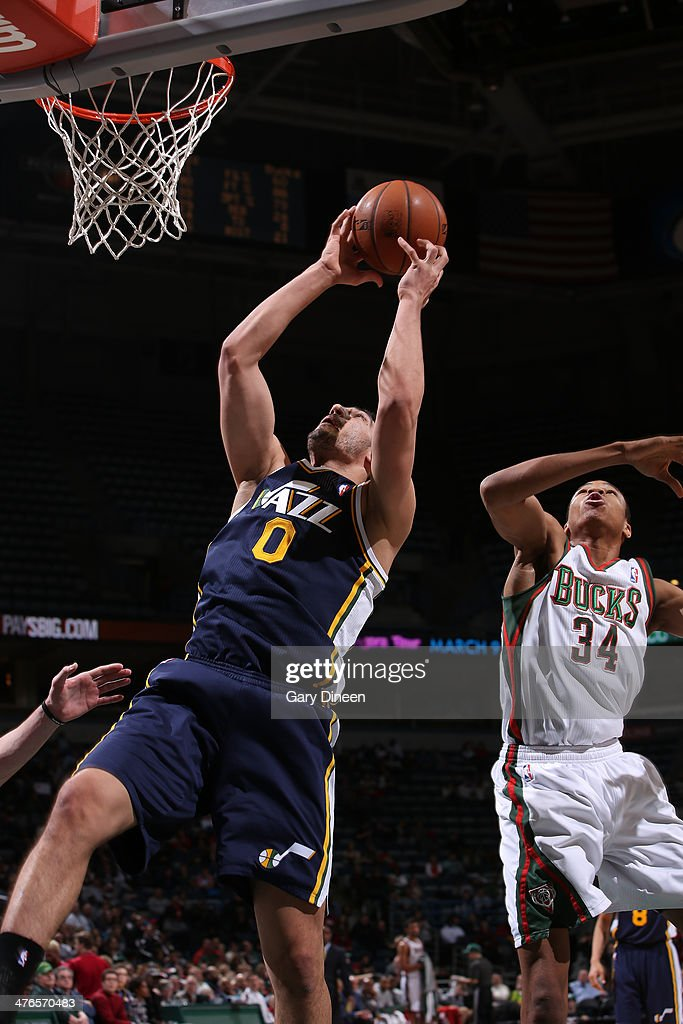 Enes Kanter #0 of the Utah Jazz shoots against Giannis Antetokounmpo #34 of the Milwaukee Bucks on March 3, 2014 at the BMO Harris Bradley Center in Milwaukee, Wisconsin.