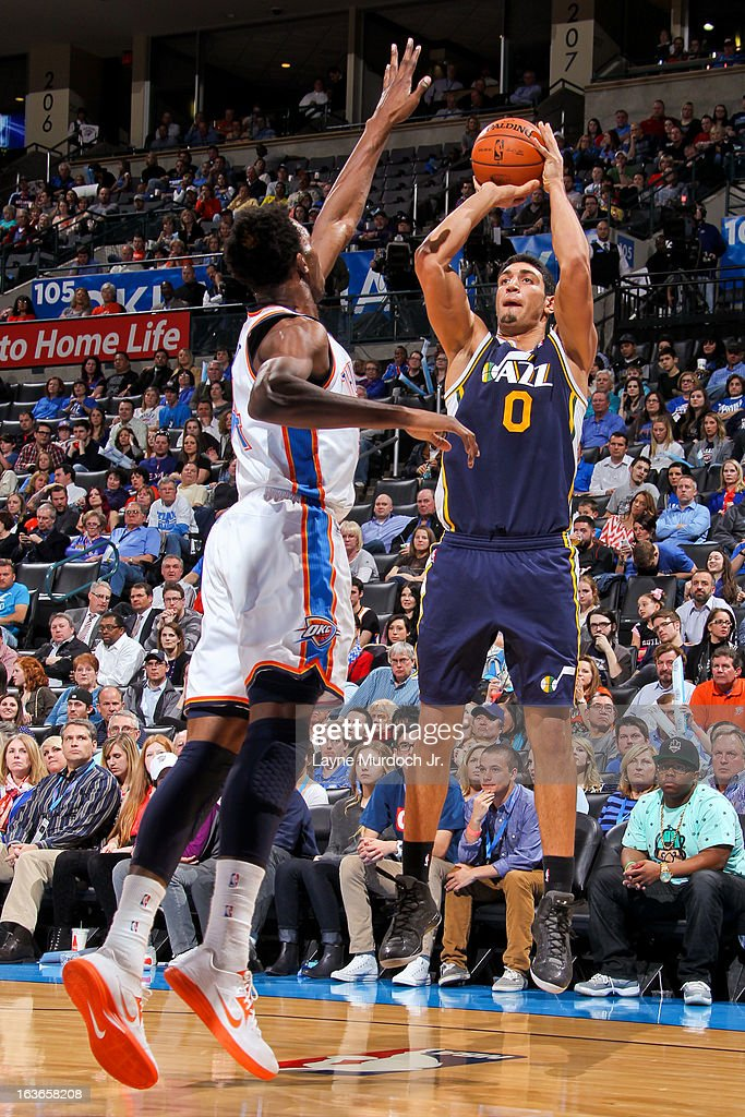 Enes Kanter #0 of the Utah Jazz shoots against Hasheem Thabeet #34 of the Oklahoma City Thunder on March 13, 2013 at the Chesapeake Energy Arena in Oklahoma City, Oklahoma.