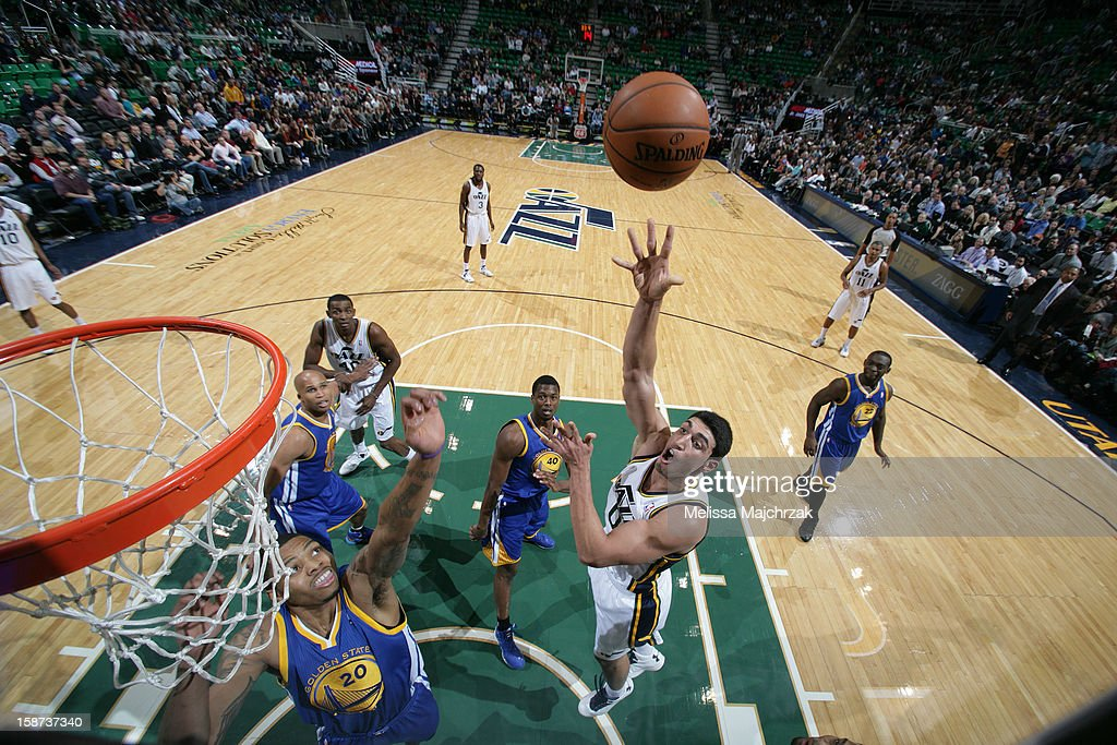 <a gi-track='captionPersonalityLinkClicked' href=/galleries/search?phrase=Enes+Kanter&family=editorial&specificpeople=5621416 ng-click='$event.stopPropagation()'>Enes Kanter</a> #0 of the Utah Jazz shoots against <a gi-track='captionPersonalityLinkClicked' href=/galleries/search?phrase=Kent+Bazemore&family=editorial&specificpeople=6846101 ng-click='$event.stopPropagation()'>Kent Bazemore</a> #20 of the Golden State Warriors at Energy Solutions Arena on December 26, 2012 in Salt Lake City, Utah.