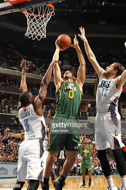 Enes Kanter of the Utah Jazz shoots against the Charlotte Bobcats during the game at the Time Warner Cable Arena on December 21 2013 in Charlotte...