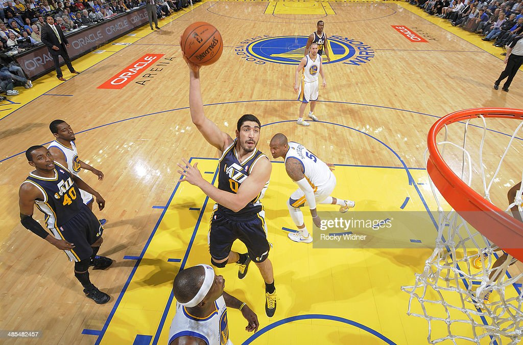 <a gi-track='captionPersonalityLinkClicked' href=/galleries/search?phrase=Enes+Kanter&family=editorial&specificpeople=5621416 ng-click='$event.stopPropagation()'>Enes Kanter</a> #0 of the Utah Jazz shoots against the Golden State Warriors on April 6, 2014 at Oracle Arena in Oakland, California.