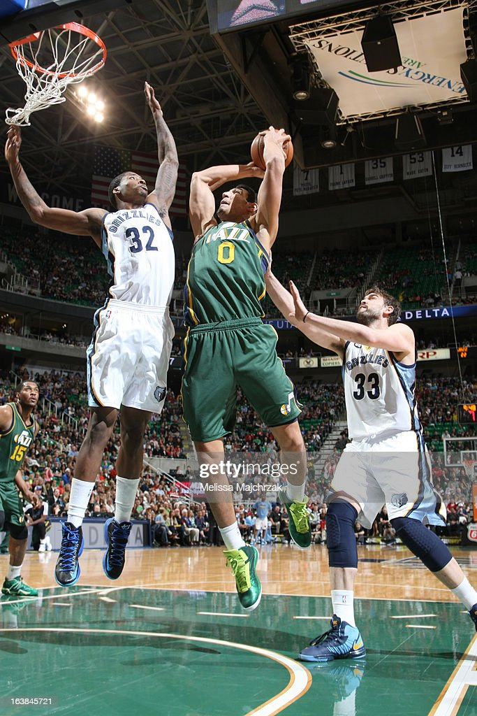Enes Kanter #0 of the Utah Jazz shoots over Ed Davis #32 and Marc Gasol #33 of the Memphis Grizzlies at Energy Solutions Arena on March 16, 2013 in Salt Lake City, Utah.